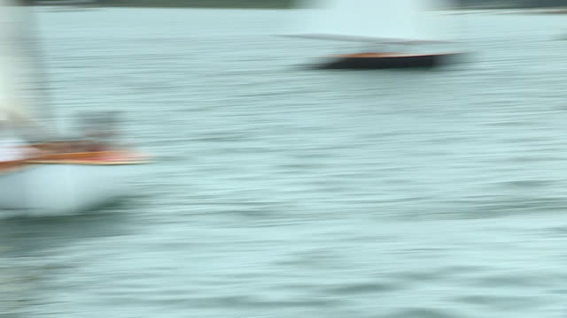 Crews sailing on Beetle Cat sailboats compete in a class championship regatta