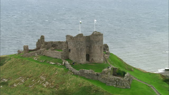 aerial, criccieth castle, wales - circa 13th century stock videos & royalty-free footage