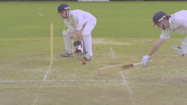 cricket, ball thrown from fielder out of frame hits the stumps directly but the batsman is just in - fielder stock videos & royalty-free footage