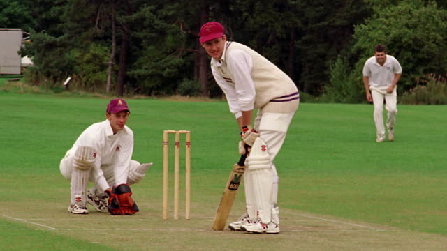 Cricket batsman hits ball next to wicket + wicketkeeper / other player in BG/ Hertfordshire, England