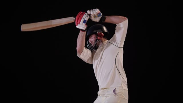 4k: cricket batsman in white hits the ball - cut shot - drive ball sports stock videos and b-roll footage