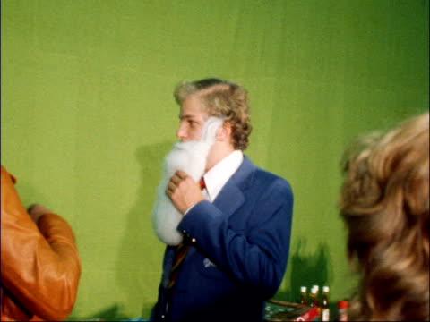england team get gear england london ms gear laid out ms ditto pull ms ken barrington ms player in father christmas beard geoffrey boycott ms boycott... - 1978 stock-videos und b-roll-filmmaterial