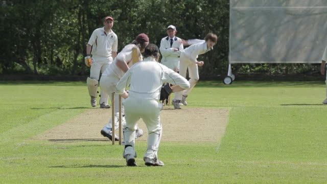 cricket match in baslow village, derbyshire, england, uk, europe - cricket ball stock videos & royalty-free footage