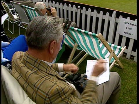 new image lib england warwickshire ext spectators watching warwickshire vs somerset cricket match gvs match in progress spectators watching scoreboard - channel 4 news stock videos & royalty-free footage