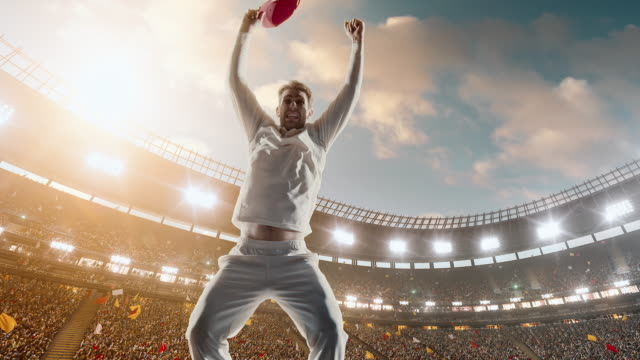 cricket player is celebrating on the stadium - batting stock videos & royalty-free footage