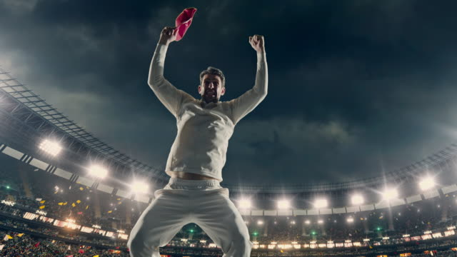 cricket player is celebrating on the stadium - cricket video stock e b–roll