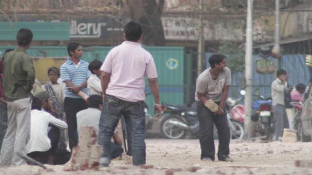 ws cricket player on street hitting ball / delhi, delhi , india - cricket video stock e b–roll