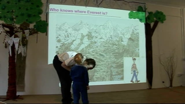 cricket team's mount everest mission day five england epping avon house school int members of team meeting children at school and children putting... - cricket team stock videos and b-roll footage