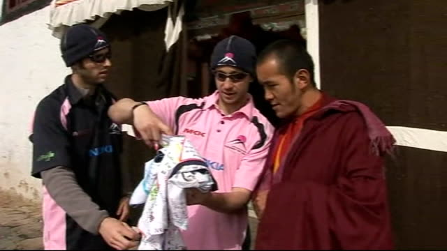 cricket team's mount everest mission day five members of expeditionary force meeting buddhist monks and showing them prayer flags made by children at... - cricket team stock videos and b-roll footage
