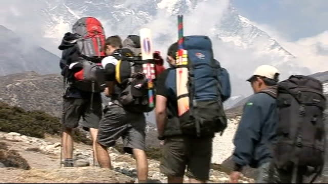 cricket team's mount everest mission day four nepal himalayas mount everest ext expedition team along mountain path various of team member receiving... - cricket team stock videos & royalty-free footage