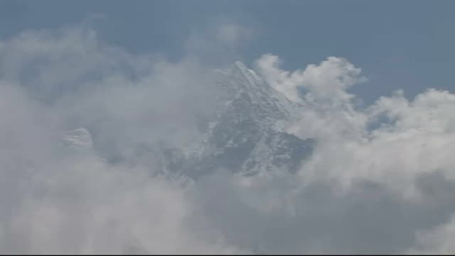cricket team's mount everest mission day two unidentified monument in everest foothills everest seen through clouds from foothills - cricket team stock videos and b-roll footage