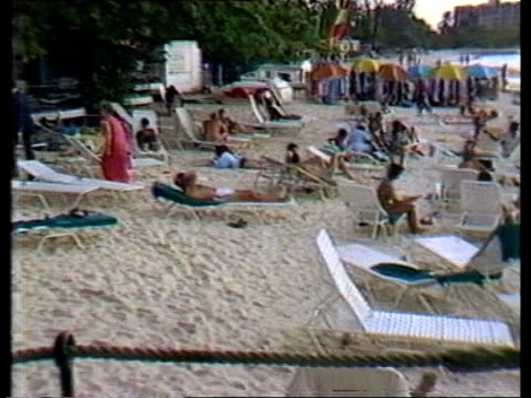 vídeos de stock e filmes b-roll de cricket tour barbados ms jackman at reception ms pan beach ms girl with towel pull out sits in chair on beach sof quotwell barbados involved herquot... - índias ocidentais