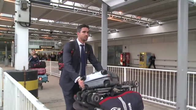 cricketer kevin pietersen flies into heathrow on his own after leaving england team after row with management on australian tour pushes trolley laden... - trolley stock videos and b-roll footage