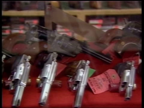 calls for change in gun laws itn handguns in display case in gun shop pan vox pops teenage boy on availability of guns - gun shop stock videos and b-roll footage