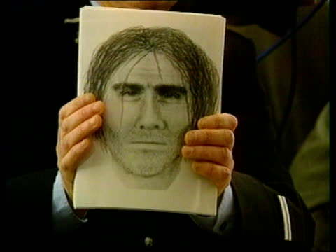 caroline dickinson investigation itn france rennes french police officer holding up photofit of suspect pull out as seated at pkf - 犯罪捜査点の映像素材/bロール