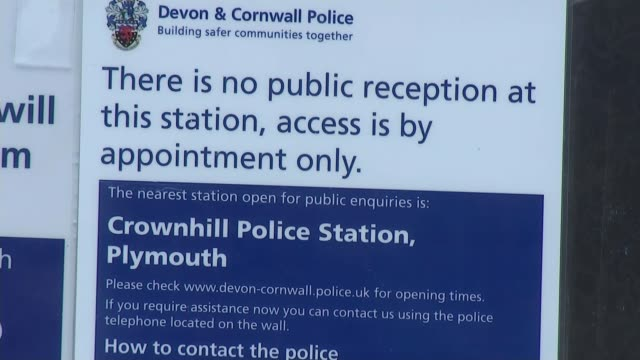 crime commissioners threaten legal action over police cuts england devon okehampton ext traffic along road woman along with shopping bags leaves on... - closed sign stock videos and b-roll footage