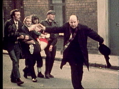 crime /conflict bloody sunday journalists refuse to name soldiers lib 30172 ms priest father edward daly leading group of men carrying bloody sunday... - priest stock videos & royalty-free footage