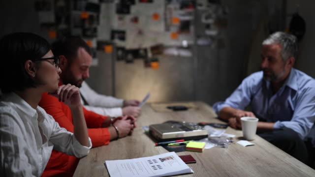 crime interrogation in police station - prisoner orange stock videos & royalty-free footage
