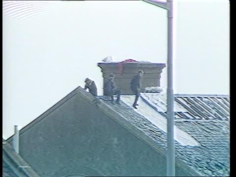peterhead prison siege; scotland, nr aberdeen peterhead jail gv prison as inmate walking around on roof lms inmate on roof as slogan daubed on roof... - hoy stock videos & royalty-free footage