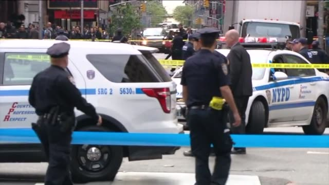 WPIX Crime scene after a knifewielding man was shot and killed by police in Midtown Manhattan on May 18 2016 and during the chaos a bystander was...