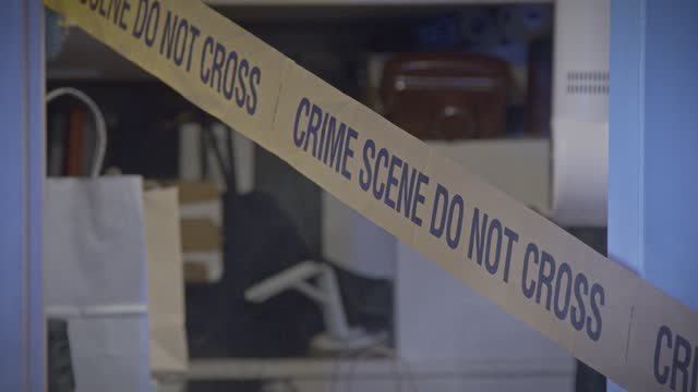 crime scene barricade tape - red tape stock videos & royalty-free footage