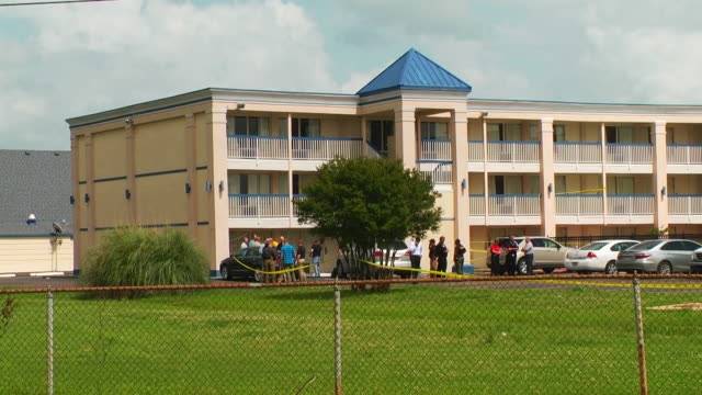 Crime scene exteriors at Days Inn Hotel in Bossier Louisiana where a missing Texas girl was found on May 26th 2015 An FBI agent was shot and the...