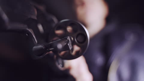 crime scene. man's hand holding a revolver - handgun stock videos & royalty-free footage