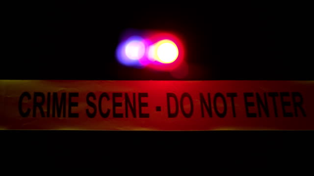 4K: Crime Scene Police Tape with sirens behind
