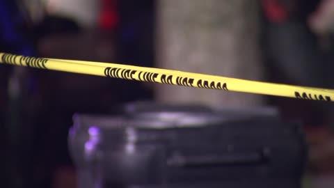 police investigate the scene of a shooting crime scene tape on august 06, 2013 in montclair, new jersey - 犯罪 個影片檔及 b 捲影像
