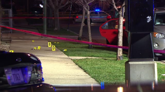 wgn crime scene with crime tape and evidence markers on december 10 2012 in chicago illinois - shooting crime stock videos & royalty-free footage