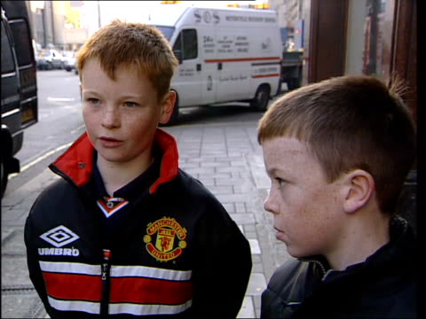 Shopkeepers Sell Restricted Goods to Children ENGLAND Manchester Pair of ten year old boys along street into shop during undercover shopping...