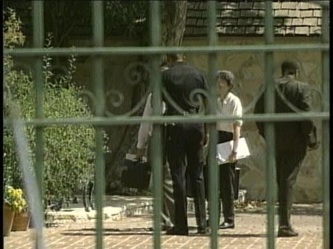 crime technicians arrive to oj simpsons house - orange juice stock videos & royalty-free footage