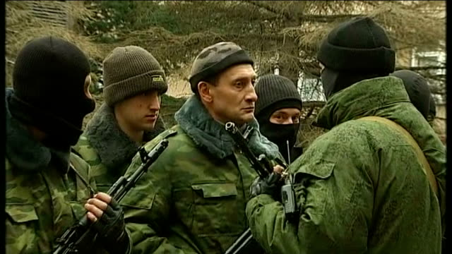 new army sworn in ukraine crimea simferopol ext armed men in army fatigues and balaclavas preparing tables and music for recruitment event for new... - wladimir putin stock-videos und b-roll-filmmaterial