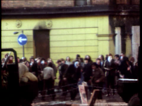 crime/conflict bloody sunday inquiry paras appeal lib 30172 northern ireland londonderry ls rioters throwing stones towards cbv british soldiers... - derry northern ireland stock videos & royalty-free footage