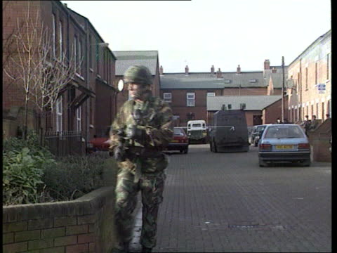 crime/conflict shooting northern ireland belfast car parked outside house ms soldier across street in f/g amp past zoom in cordoned off car in b/g ms... - belfast stock videos & royalty-free footage