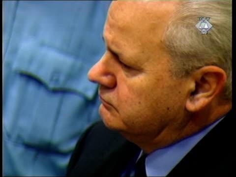 slobodan milosevic war crimes trial begins; tcs & milosevic in court - slobodan milosevic stock-videos und b-roll-filmmaterial