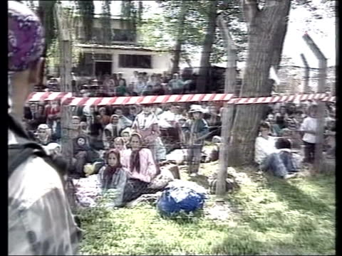 slobodan milosevic war crimes trial; lib bosnia herzegovina: tuzla: ext gvs muslim refugees in camp - slobodan milosevic stock-videos und b-roll-filmmaterial