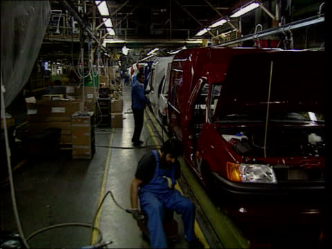ford racism row lib dagenham workers working on production line at dagenham car plant pull black worker working on van workers working on vehicle - dagenham stock videos & royalty-free footage