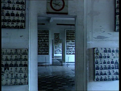 pol pot surrendered itn phnom penh rooms lined with photos of murdered people - southeast asia stock videos & royalty-free footage