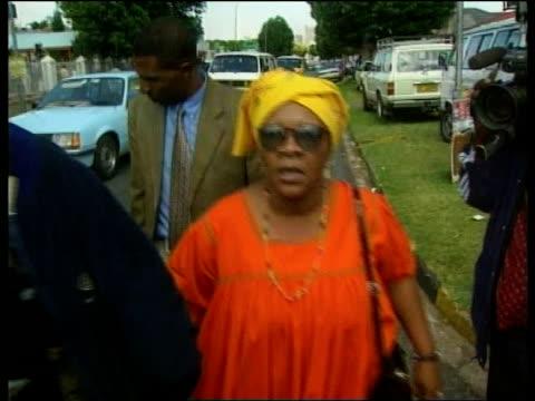 Crime/Politics Winnie Mandela ITN Ext Winnie smiling Caroline Sono walking towards shouting about Winnie apology Int People watching proceedings on...