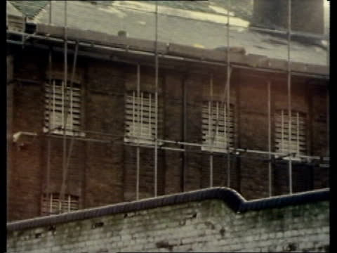 escaped ira prisoner england ms roof of prison london ms scaffolding on wall pull tx brixton ms brixton police hq lib film on cas ls ditto - prisoner uk stock videos & royalty-free footage