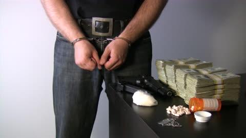 criminal arrested and handcuffed. - mittdel bildbanksvideor och videomaterial från bakom kulisserna