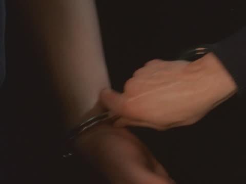 criminal being handcuffed - giuntura umana video stock e b–roll