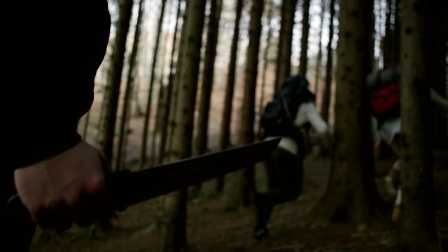 criminal chasing hikers with knife - knife weapon stock videos and b-roll footage