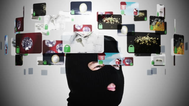 criminal in balaclava contemplating various security situations - disguise stock videos & royalty-free footage