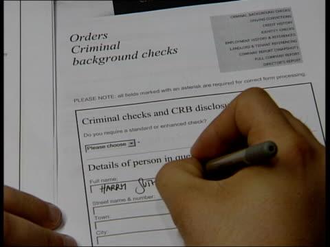 vidéos et rushes de criminal records bureau make mistakes on criminal list; top shot person filling in crb background check form nick clegg mp interview sot - we have... - malfaiteur