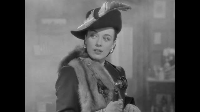 vídeos de stock, filmes e b-roll de 1946 criminal (patricia morison) sets off smoke bob and steals music box from doctor watson (nigel bruce) - mistério