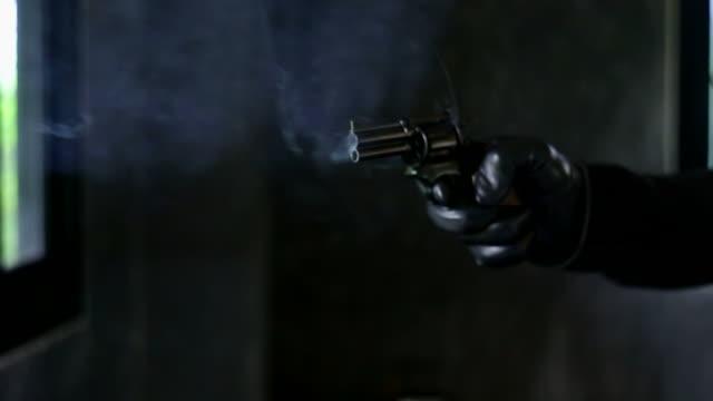 Criminal shoots gun directly at camera
