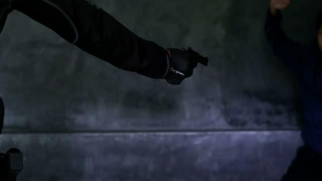criminal shoots gun directly at camera - gun barrel stock videos & royalty-free footage