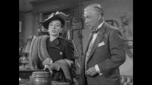 1946 criminal (patricia morison) spins sob story to doctor watson (nigel bruce) - 1946 stock videos & royalty-free footage